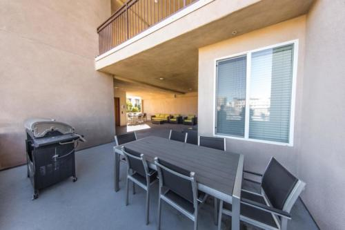 Outdoor patio with grill and table