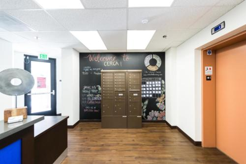 Mailboxes with chalk wall in lobby