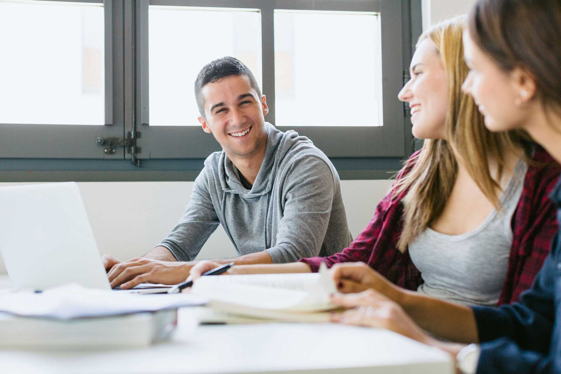 Image of students happily studying